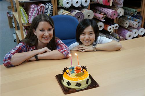 Birthday Girls Sandra and Lok with their Cake