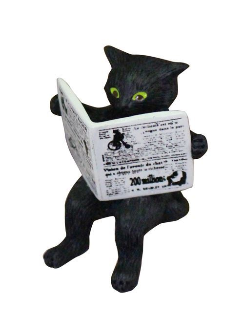 black cat reading newspaper figurine from Japan