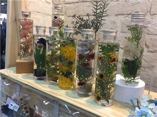 Flowers in jars of oil
