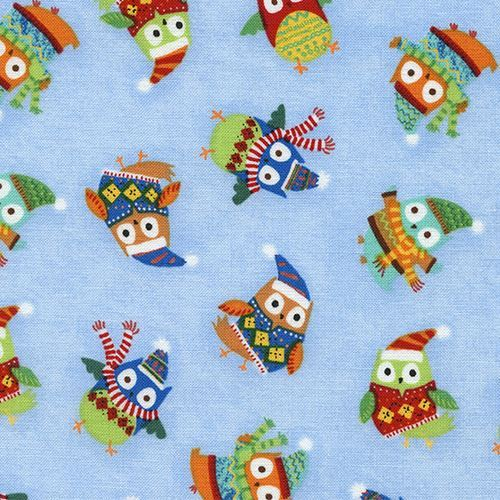 light blue fabric with colorful owl hat scarf by Timeless Treasures